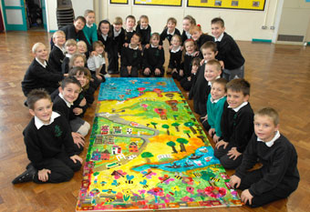 Pupils at Fair Furlong Primary with their Portrait of a Nation collage (Martin Chainey).