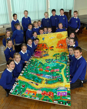 Pupils at New Oak Primary with their Portrait of a Nation collage (Martin Chainey).